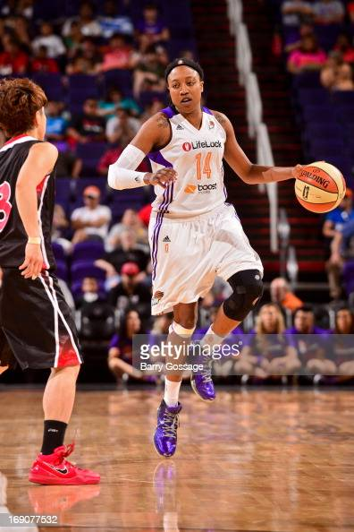 Alexis Hornbuckle of the Phoenix Mercury advances the ball against Yuko Oga of the Japanese National Team during a WNBA preseason game on May 19 2013...