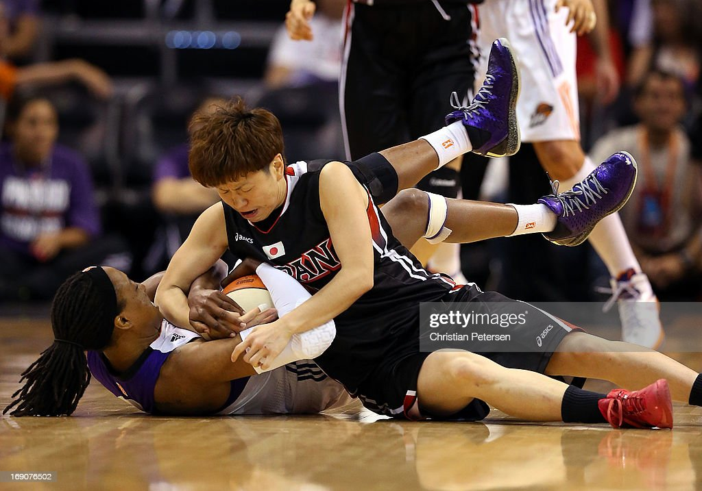 Alexis Hornbuckle #14 of the Phoenix Mercury and Yuko Oga #13 of Japan battle for a loose ball during the preseason WNBA game at US Airways Center on May 19, 2013 in Phoenix, Arizona.