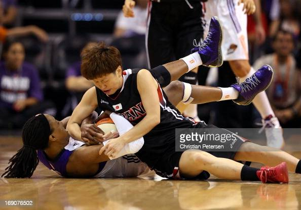 Alexis Hornbuckle of the Phoenix Mercury and Yuko Oga of Japan battle for a loose ball during the preseason WNBA game at US Airways Center on May 19...