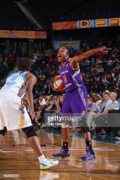 Alexis Hornbuckle of the Phoenix Mercury calls out to her teammates while being guarded by Epiphanny Prince of the Chicago Sky during the game on...