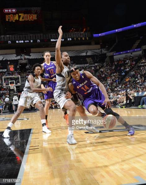 Alexis Hornbuckle of the Phoenix Mercury drives against Davellyn Whyte of the San Antonio Silver Stars at the ATT Center on June 25 2013 in San...