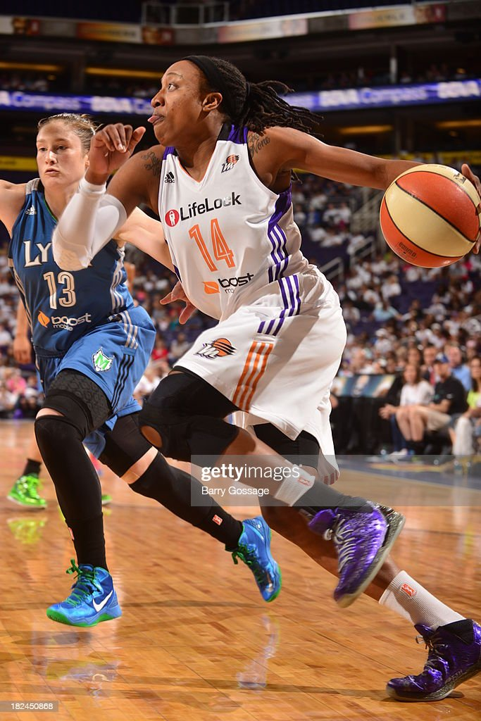 <a gi-track='captionPersonalityLinkClicked' href=/galleries/search?phrase=Alexis+Hornbuckle&family=editorial&specificpeople=2081416 ng-click='$event.stopPropagation()'>Alexis Hornbuckle</a> #14 of the Phoenix Mercury drives against <a gi-track='captionPersonalityLinkClicked' href=/galleries/search?phrase=Lindsay+Whalen&family=editorial&specificpeople=208984 ng-click='$event.stopPropagation()'>Lindsay Whalen</a> #13 of the Minnesota Lynx in Game 2 of the Western Conference Finals during 2013 WNBA Playoffs on September 29, 2013 at U.S. Airways Center in Phoenix, Arizona.