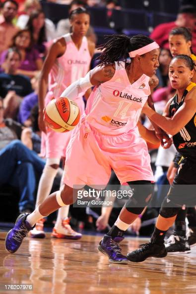 Alexis Hornbuckle of the Phoenix Mercury drives against of the Tulsa Shock during a game on August 11 2013 at US Airways Center in Phoenix Arizona...