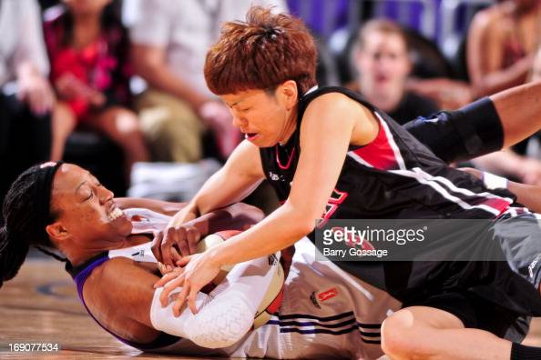 Alexis Hornbuckle of the Phoenix Mercury fights for a loose ball against Yuko Oga of the Japanese National Team during a WNBA preseason game on May...