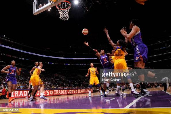 Alexis Hornbuckle of the Phoenix Mercury gets to the hoop against the Los Angeles Sparks at Staples Center on September 15 2013 in Los Angeles...