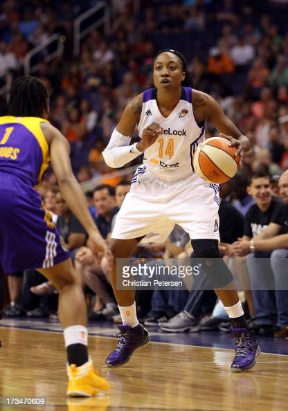 Alexis Hornbuckle of the Phoenix Mercury handles the ball during the WNBA game against the Los Angeles Sparks at US Airways Center on July 14 2013 in...