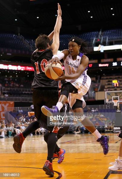 Alexis Hornbuckle of the Phoenix Mercury passes the ball around Arisa Fujiwara of Japan during the preseason WNBA game at US Airways Center on May 19...