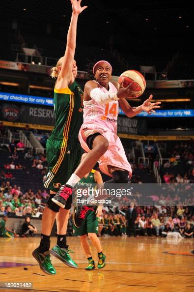 Alexis Hornbuckle of the Phoenix Mercury shoots against Ann Wauters of the Seattle Storm on September 23 2012 at US Airways Center in Phoenix Arizona...