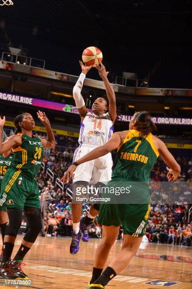 Alexis Hornbuckle of the Phoenix Mercury shoots against Camille Little of the Seattle Storm on August 23 2013 at US Airways Center in Phoenix Arizona...