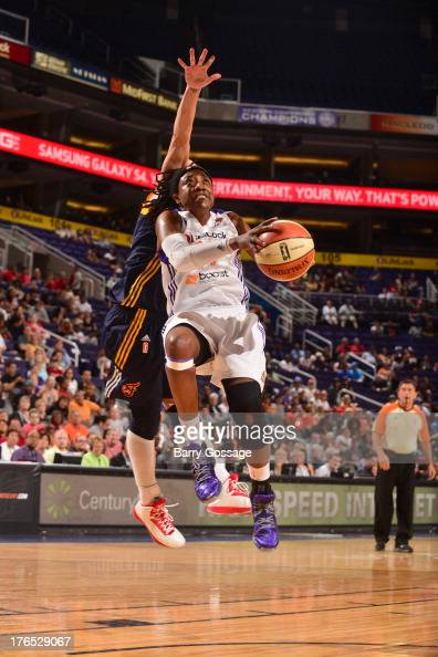 Alexis Hornbuckle of the Phoenix Mercury shoots against Erin Phillips of the Indiana Fever on August 14 2013 at US Airways Center in Phoenix Arizona...