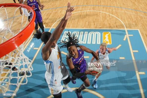 Alexis Hornbuckle of the Phoenix Mercury shoots against Sylvia Fowles of the Chicago Sky during the game on September 11 2013 at the Allstate Arena...