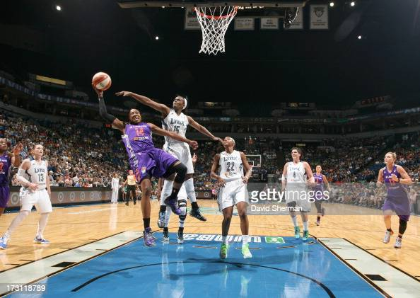 Alexis Hornbuckle of the the Phoenix Mercury attempts to shoot over Ta'Shauna ''Sugar'' Rodgers of the Minnesota Lynx during the WNBA game on July 7...
