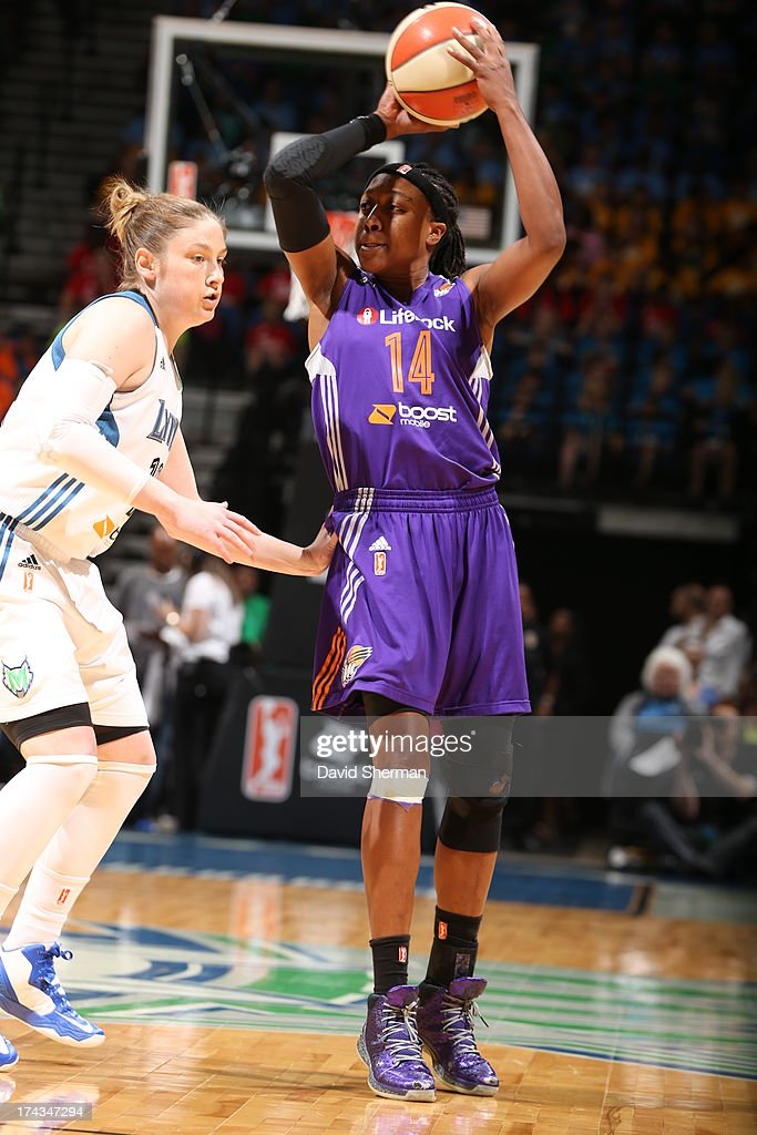 Alexis Hornbuckle #14 of the the Phoenix Mercury looks to pass Lindsay Whalen #13 of the Minnesota Lynx during the WNBA game on July 24, 2013 at Target Center in Minneapolis, Minnesota.