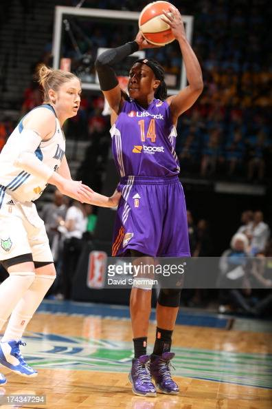 Alexis Hornbuckle of the the Phoenix Mercury looks to pass Lindsay Whalen of the Minnesota Lynx during the WNBA game on July 24 2013 at Target Center...