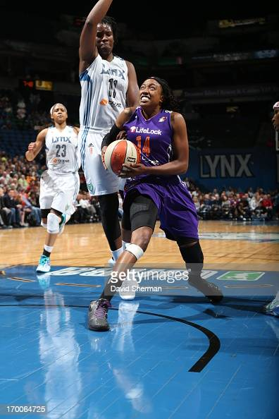Alexis Hornbuckle of the the Phoenix Mercury shoots against Amber Harris of the Minnesota Lynx during the WNBA game on June 6 2013 at Target Center...