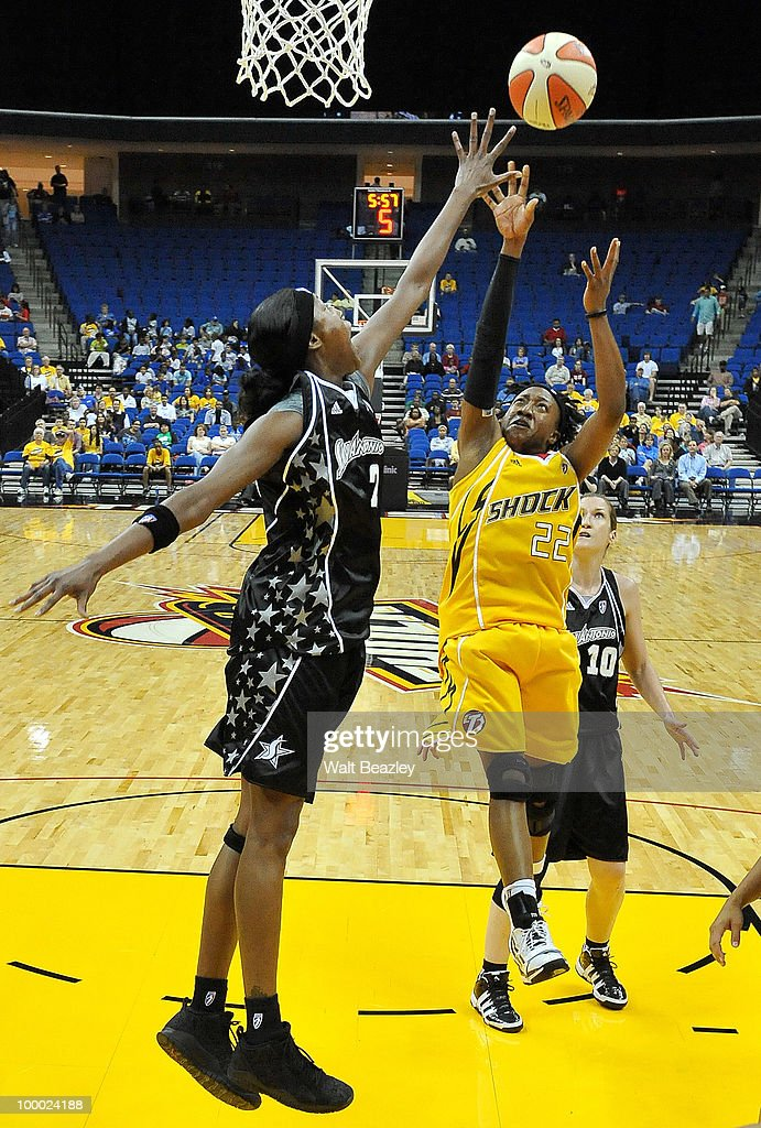 Alexis Hornbuckle #22 of the Tulsa Shock lays up a shot against Michelle Snow #2 of the San Antonio Silver Stars at the Bok Center May 20, 2010 in Tulsa, Oklahoma.