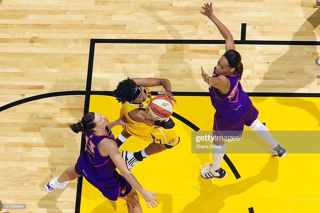 Alexis Hornbuckle #22 of the Tulsa Shock takes the ball to the basket against Penny Taylor #13 and Tangela Smith #50 of the Phoenix Mercury during the WNBA game on May 25, 2010 at the BOK Center in Tulsa, Oklahoma. The Mercury won 110-96.