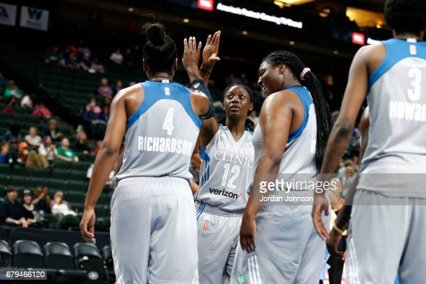 Alexis Jones and Breanna Richardson of the Minnesota Lynx high five each other during the game against the Atlanta Dream during the preseason WNBA...