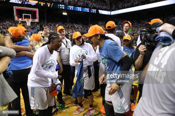 Alexis Jones and Maya Moore of the Minnesota Lynx celebrate a win against the Los Angeles Sparks in Game 5 of the 2017 WNBA Finals on October 4 2017...