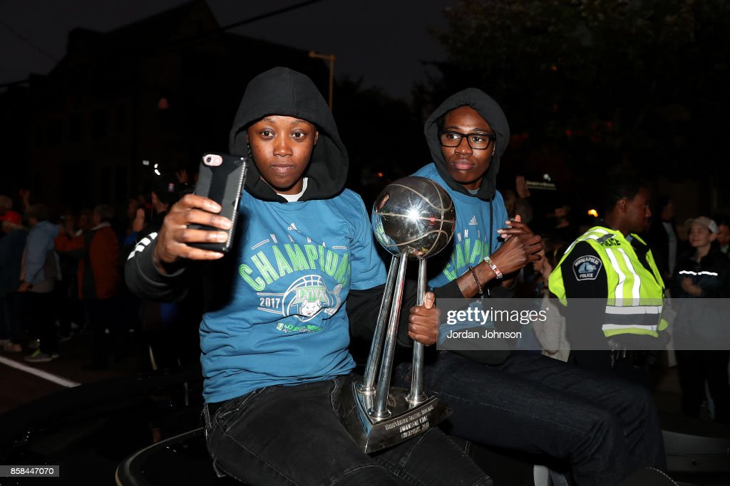 Alexis Jones #12 and Natasha Howard #3 of the Minnesota Lynx take a picture together during the Minnesota Lynx title parade on October 5, 2017 at The University of Minnesota Williams Arena in Minneapolis, Minnesota.