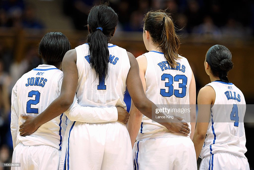 Alexis Jones #2, Elizabeth Williams #1, Haley Peters #33, and Chloe Wells #4 of the Duke Blue Devils look on as their teammate Tricia Liston #32 (not pictured) shoots a technical free throw against the North Carolina Tar Heels at Cameron Indoor Stadium on March 3, 2013 in Durham, North Carolina. Duke defeated North Carolina 65-58.