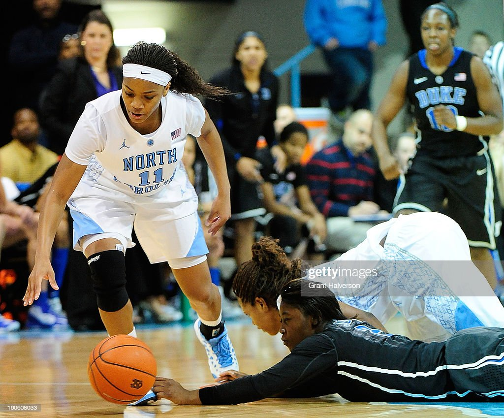 Alexis Jones #2 of the Duke Blue Devils battles for a loose ball with Brittany Rountree #11 and Xylina McDaniel #34 of the North Carolina Tar Heels during play at Carmichael Arena on February 3, 2013 in Chapel Hill, North Carolina. Duke won 84-63.