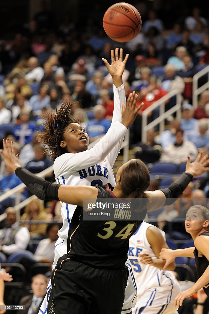 Alexis Jones #2 of the Duke Blue Devils puts up a shot against Chelsea Davis #34 of the Florida State Seminoles during the semifinals of the 2013 Women's ACC Tournament at the Greensboro Coliseum on March 9, 2013 in Greensboro, North Carolina.