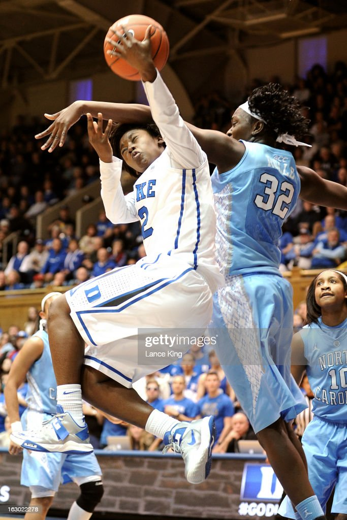 Alexis Jones #2 of the Duke Blue Devils puts up a shot against Waltiea Rolle #32 of the North Carolina Tar Heels at Cameron Indoor Stadium on March 3, 2013 in Durham, North Carolina.