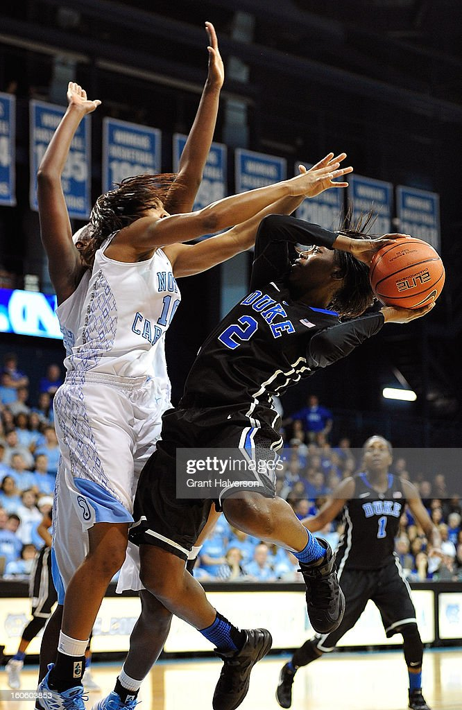 Alexis Jones #2 of the Duke Blue Devils shoots against Danielle Butts #10 of the North Carolina Tar Heels during play at Carmichael Arena on February 3, 2013 in Chapel Hill, North Carolina.