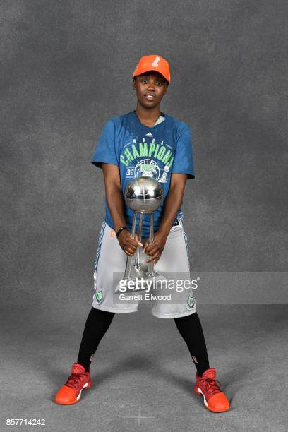 Alexis Jones of the Minnesota Lynx poses for a portrait while holding the 2017 WNBA Championship trophy after the game against the Los Angeles Sparks...