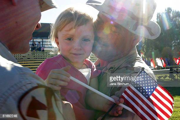 Alexis King age three welcomes father Daniel King and grandfather David King home from Iraq on November 6 2004 in Fort Hood Texas The Kings are...