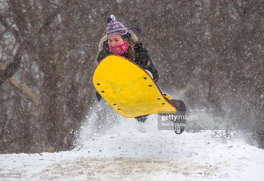 Alexis Lane, 13, of Newburyport, got some air while sledding on March's Hill as a winter storm, expected to dump as much as 24 inches of snow in the region, intensified in Newburyport.