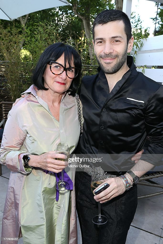 Alexis Mabille (R) and his mother attend the Chambre Syndicale de la Haute Couture cocktail party at Palais De Tokyo on July 4, 2013 in Paris, France.