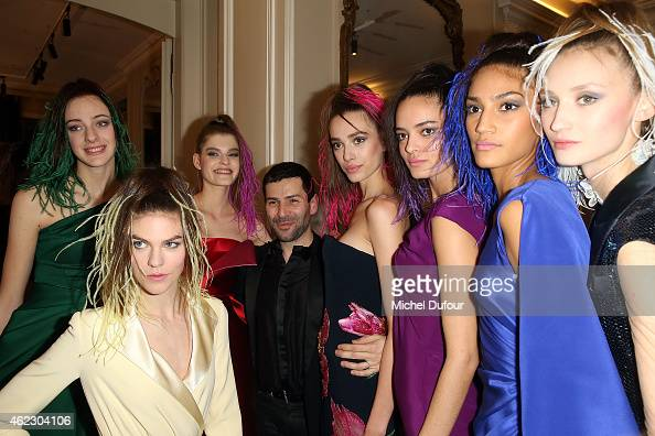 Alexis Mabille and models pose backstage after the Alexis Mabille show as part of Paris Fashion Week HauteCouture Spring/Summer 2015 on January 26...