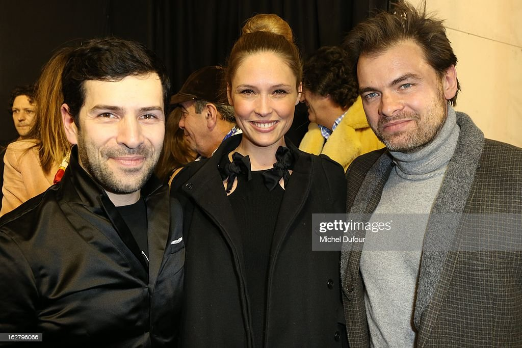 Alexis mabille, Lilou Fogli and Clovis Cornillac attend the Alexis Mabille Fall/Winter 2013 Ready-to-Wear show as part of Paris Fashion Week on February 27, 2013 in Paris, France.