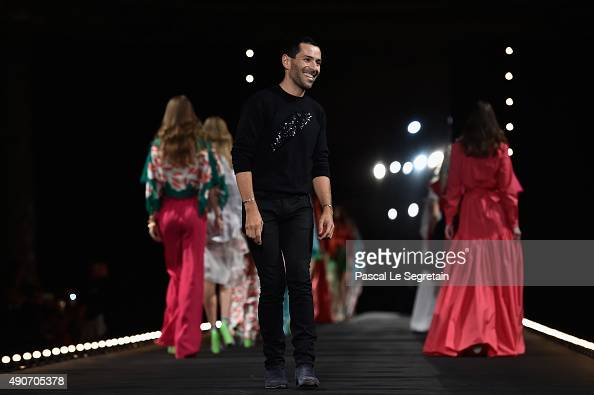 Alexis Mabille poses on the runway during the Alexis Mabille show as part of the Paris Fashion Week Womenswear Spring/Summer 2016 on September 30...