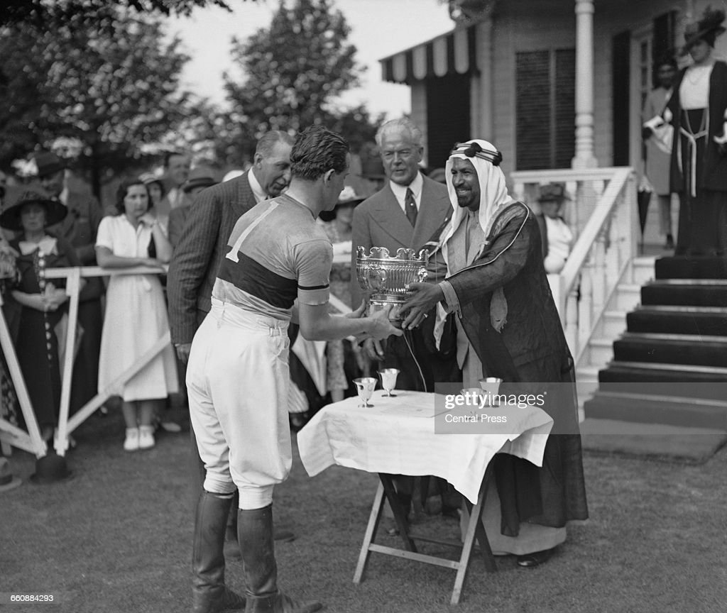 Alexis Mdivani captain of the Los Diables polo team receives the cup from Sheikh Ahmad AlJaber AlSabah the Emir of Kuwait after beating Kashmir in...