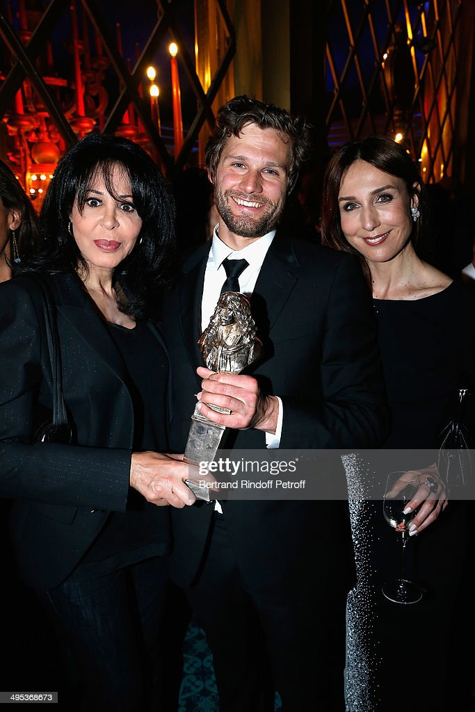 Alexis Michalik (C), winner of the Molieres of Francophone living Author and Moliere of Director of a private theater show for 'Le Porteur d'histoire' and Le Cercle des illusionnistes' pose with Yamina Benguigui (L) and Elsa Zylberstein (R) after the 26th Molieres Awards Ceremony at Folies Bergere on June 2, 2014 in Paris, France.