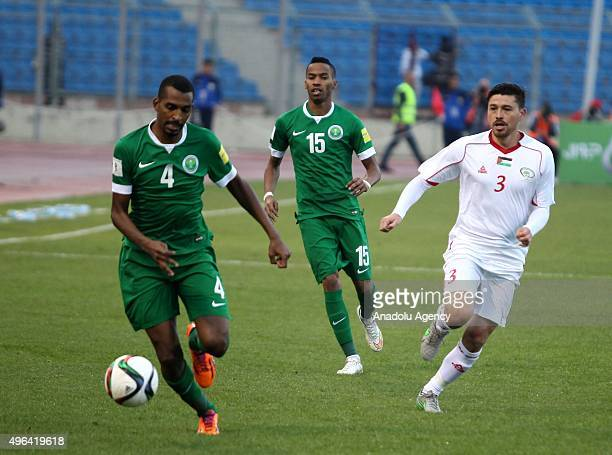 Alexis Norambuena of Palestinian national team and Abdullah Alzori of Saudi Arabia contest the ball during the AFC qualifying Group A football match...