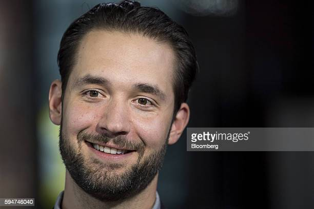Alexis Ohanian chairman and cofounder of Reddit Inc smiles during a Bloomberg West television interview in San Francisco California US on Tuesday Aug...