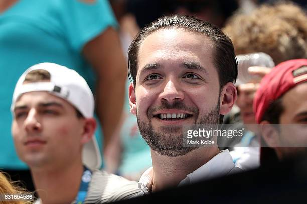 Alexis Ohanian fiance of Serena Williams of the United States watches her first round match against Belinda Bencic of Switzerland on day two of the...