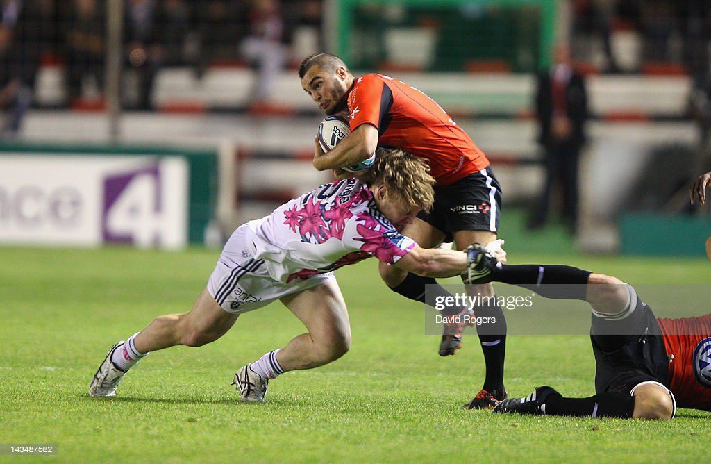 <a gi-track='captionPersonalityLinkClicked' href=/galleries/search?phrase=Alexis+Palisson&family=editorial&specificpeople=5365066 ng-click='$event.stopPropagation()'>Alexis Palisson</a> of Toulon is tackled by <a gi-track='captionPersonalityLinkClicked' href=/galleries/search?phrase=Aled+de+Malmanche&family=editorial&specificpeople=1036719 ng-click='$event.stopPropagation()'>Aled de Malmanche</a> during the Amlin Challenge Cup semi final match between Toulon and Stade Francais at Stade Felix Mayol on April 27, 2012 in Toulon, France.