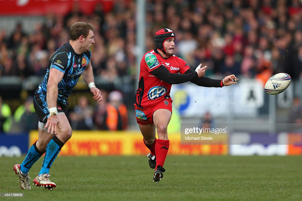 Alexis Palisson (R) of Toulon is watched by Matt Jess (L) of Exeter Chiefs during the Heineken Cup Pool Two match between Exeter Chiefs and Toulon at Sandy Park on December 7, 2013 in Exeter, England.