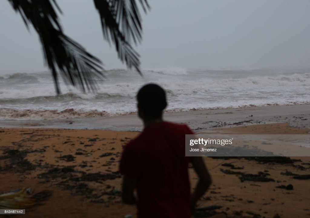 Alexis Ramos looks out to sea at Luquillo Beach prior to the passing of Hurricane Irma on September 6, 2017 in San Juan, Puerto Rico. The category 5 storm is expected to pass over Puerto Rico and the Virgin Islands today, and make landfall in Florida by the weekend.