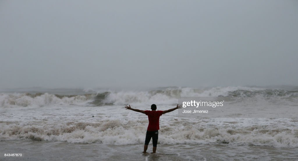 Alexis Ramos stands in the ocean at Luquillo Beach prior to the passing of Hurricane Irma on September 6, 2017 in San Juan, Puerto Rico. The category 5 storm is expected to pass over Puerto Rico and the Virgin Islands on today, and make landfall in Florida by the weekend.