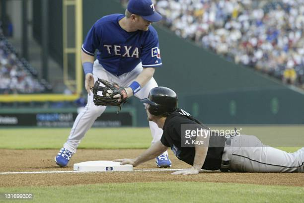 Alexis Rios left fielder for the Toronto Blue Jays just barely beats a throw by Rangers outfielder Gary Matthews during the 75 loss to the Texas...