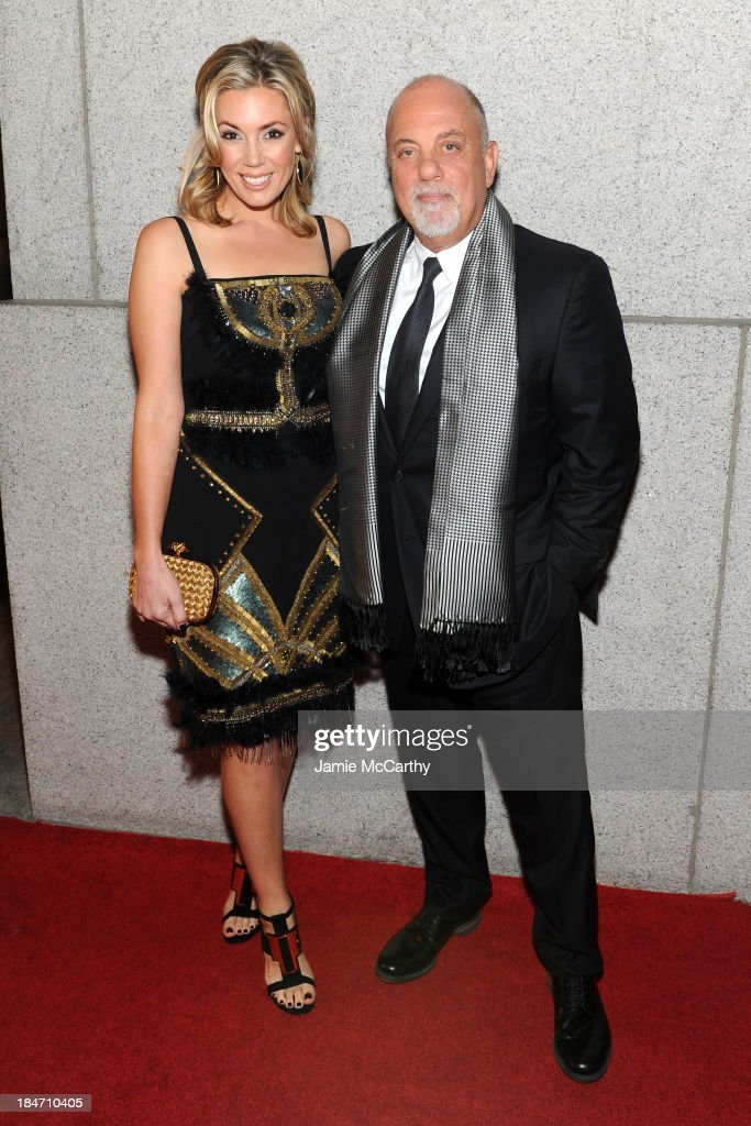 <a gi-track='captionPersonalityLinkClicked' href=/galleries/search?phrase=Alexis+Roderick&family=editorial&specificpeople=8355331 ng-click='$event.stopPropagation()'>Alexis Roderick</a> and <a gi-track='captionPersonalityLinkClicked' href=/galleries/search?phrase=Billy+Joel&family=editorial&specificpeople=203097 ng-click='$event.stopPropagation()'>Billy Joel</a> attend the Elton John AIDS Foundation's 12th Annual An Enduring Vision Benefit at Cipriani Wall Street on October 15, 2013 in New York City.