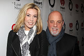 Alexis Roderick and Billy Joel pose at The Opening Night of 'The Last Ship' on Broadway at The Neil Simon Theatre on October 26 2014 in New York City