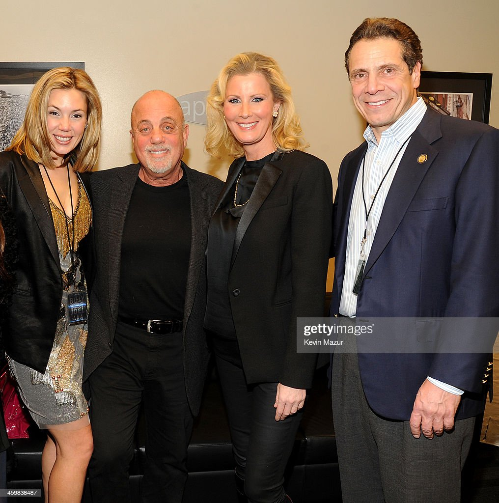 Alexis Roderick, <a gi-track='captionPersonalityLinkClicked' href=/galleries/search?phrase=Billy+Joel&family=editorial&specificpeople=203097 ng-click='$event.stopPropagation()'>Billy Joel</a>, <a gi-track='captionPersonalityLinkClicked' href=/galleries/search?phrase=Sandra+Lee+-+Television+Personality&family=editorial&specificpeople=242799 ng-click='$event.stopPropagation()'>Sandra Lee</a>, and New York Governor <a gi-track='captionPersonalityLinkClicked' href=/galleries/search?phrase=Andrew+Cuomo&family=editorial&specificpeople=228332 ng-click='$event.stopPropagation()'>Andrew Cuomo</a> pose backstage at the <a gi-track='captionPersonalityLinkClicked' href=/galleries/search?phrase=Billy+Joel&family=editorial&specificpeople=203097 ng-click='$event.stopPropagation()'>Billy Joel</a> New Year's Eve Concert at the Barclays Center of Brooklyn on December 31, 2013 in New York City.