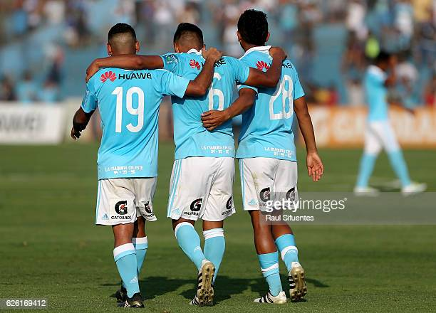 Alexis Rojas of Sporting Cristal celebrates with teammates after scoring his team's third goal of his team against FBC Melgar during a match between...